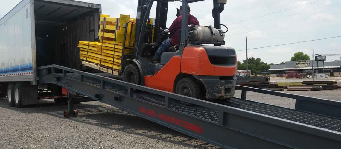 forklift truck using a steel yardramp as a portable loading ramp